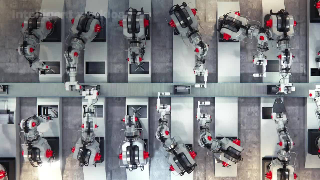 Overhead view of an assembly line with robot arms working on products