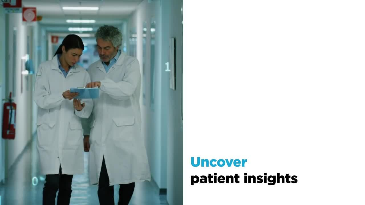 Two medical professionals looking at a clipboard next to white space with a text overlay for Uncover patient insights