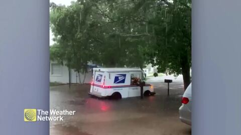 MUST SEE: POSTAL CARRIER DRIVES THROUGH DEEP FLOODWATERS TO DELIVER THE MAIL