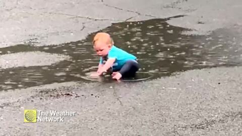 THIS BABY KNOWS HOW TO MAKE THE MOST OF THE RAIN