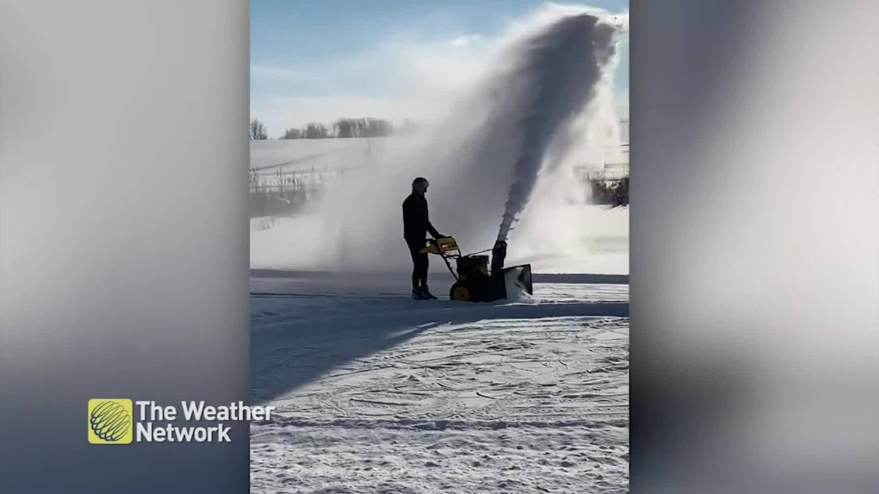 SNOWBLOWING DUDE WORKS SMARTER, NOT HARDER