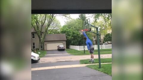 Watch this mail carrier freak out over kid's dunk in driveway