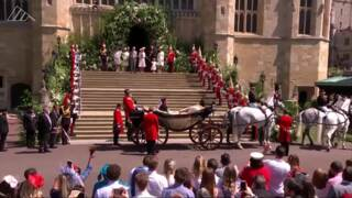 Royal newlyweds leave the castle for procession through Windsor