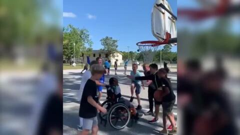 Elementary school plays inclusive basketball game with student in wheelchair
