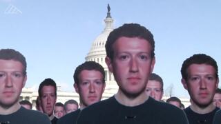 Facebook critics demonstrate ahead of Zuckerberg hearing with sea of cutouts