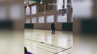 California cop drains court-length shot with back to the basket