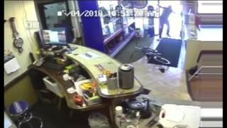 Utah pawn shop clerk shoots and kills armed robber with concealed weapon, video shows