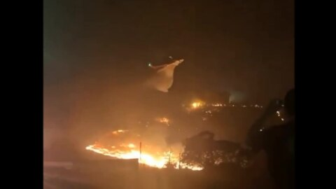 Helicopter airdrops water on huge Saddleridge Fire flames  in Los Angeles