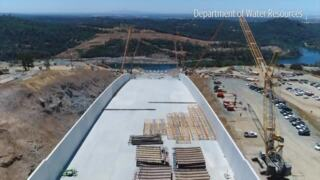 Fly up and down the massive Oroville Dam Spillway as repairs continue