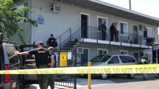 FBI officers search an Arden Arcade apartment