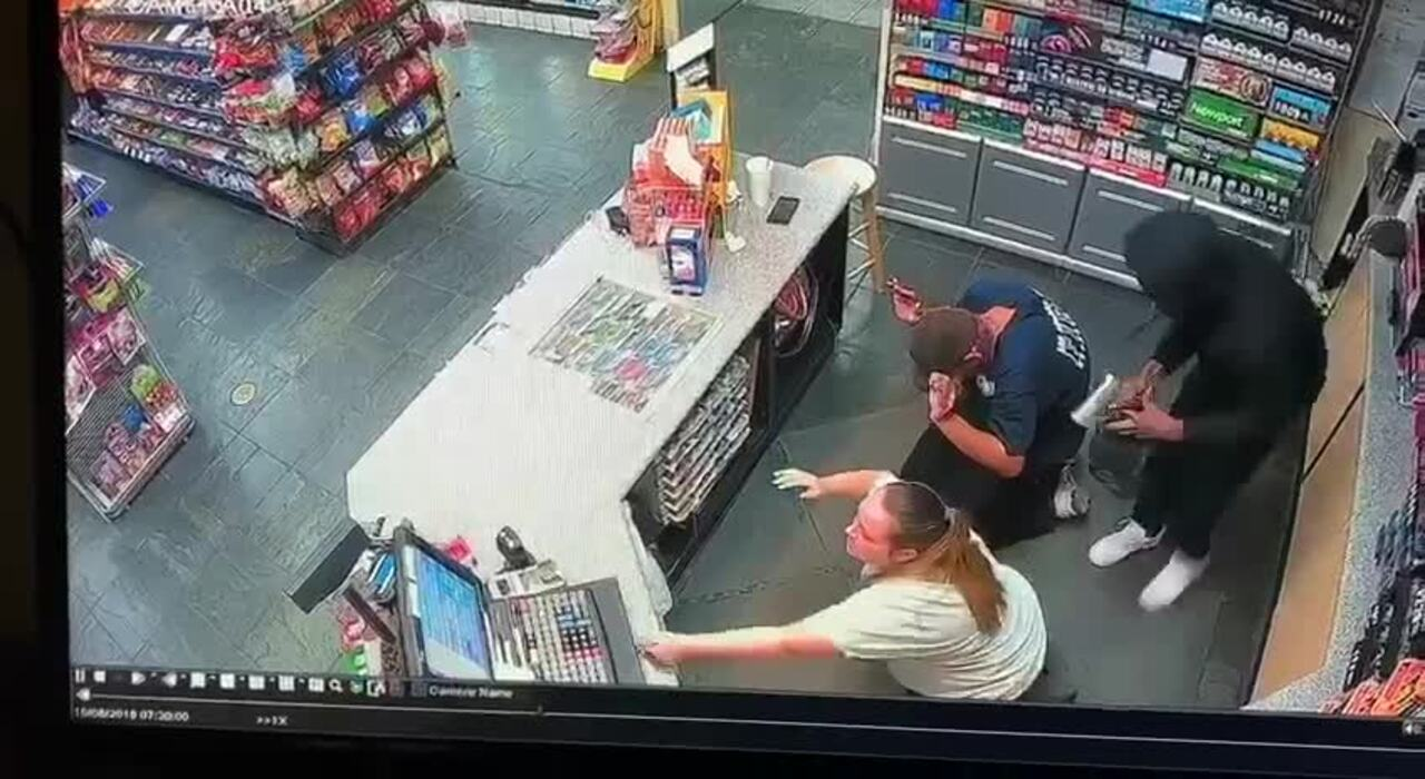 Video shows armed robber force customer, clerk to ground at Turlock convenience store