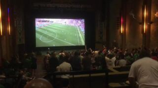 Fans celebrate at Modesto's State Theatre as Mexico upsets Germany in World Cup
