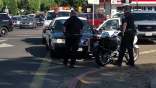 Motorcycle officer treated after collision with car in downtown Modesto