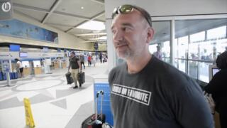 Stranded airline passenger tries to stay positive