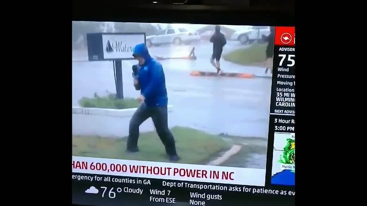weather channel defends reporter bracing against wind in