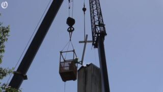 Demolition crews save the cross from Sharon UMC steeple