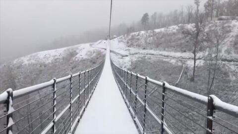 Snow falls on suspension bridge in the Great Smoky Mountains