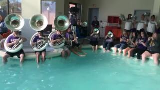 The Kansas State Marching Band prepared for Sunday's game in the hotel pool