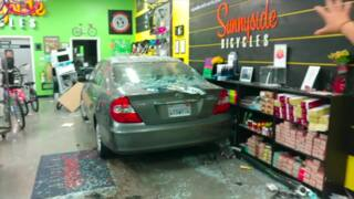 Car crashes into bike shop