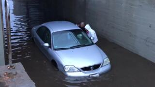 Car stuck in flooded Fresno railroad underpass