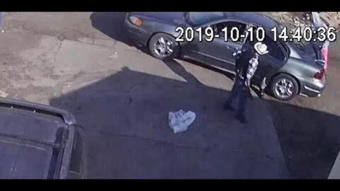 Watch as a man is robbed in an alley