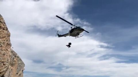 Watch rescuers in helicopter hoist woman who fell from Bishop Peak
