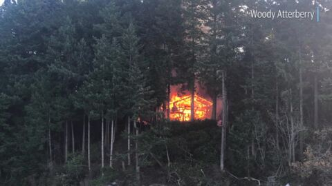 Eliza Island cabin destroyed by fire and flames spread to nearby brush