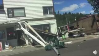Motorist video of dump truck crashed into general store