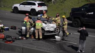 Firefighters extract injured man from a serious car accident on SR-512