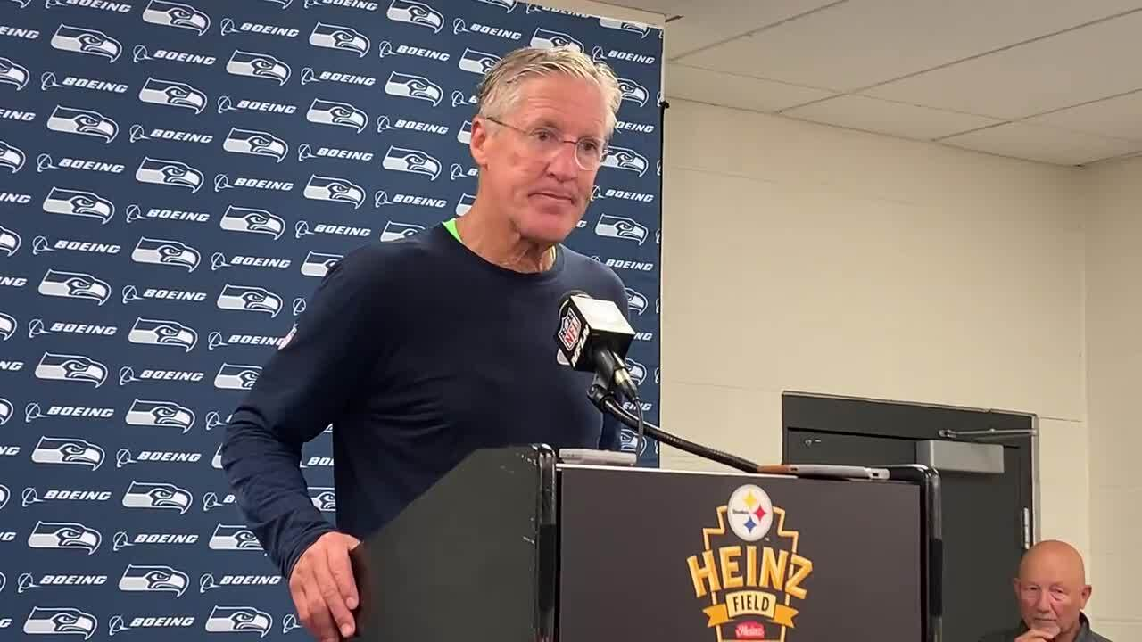 Pete Carroll enjoys getting dumped with water by Bobby Wagner, Seahawks after his 100th win on 68th...