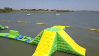 A popular floating water park is back on Grapevine Lake