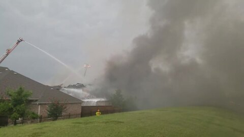 Watch: House fire in Irving possibly caused by lightning strike