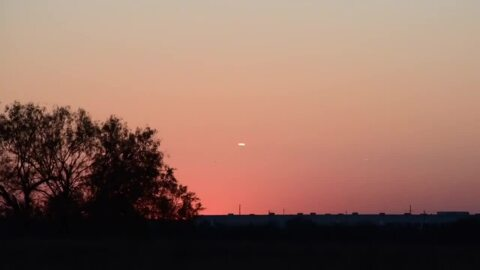 She wanted to photograph the sunset. Instead, she caught what some are calling a UFO