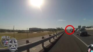 Irving PD releases footage of motorcycle officer almost getting hit by car