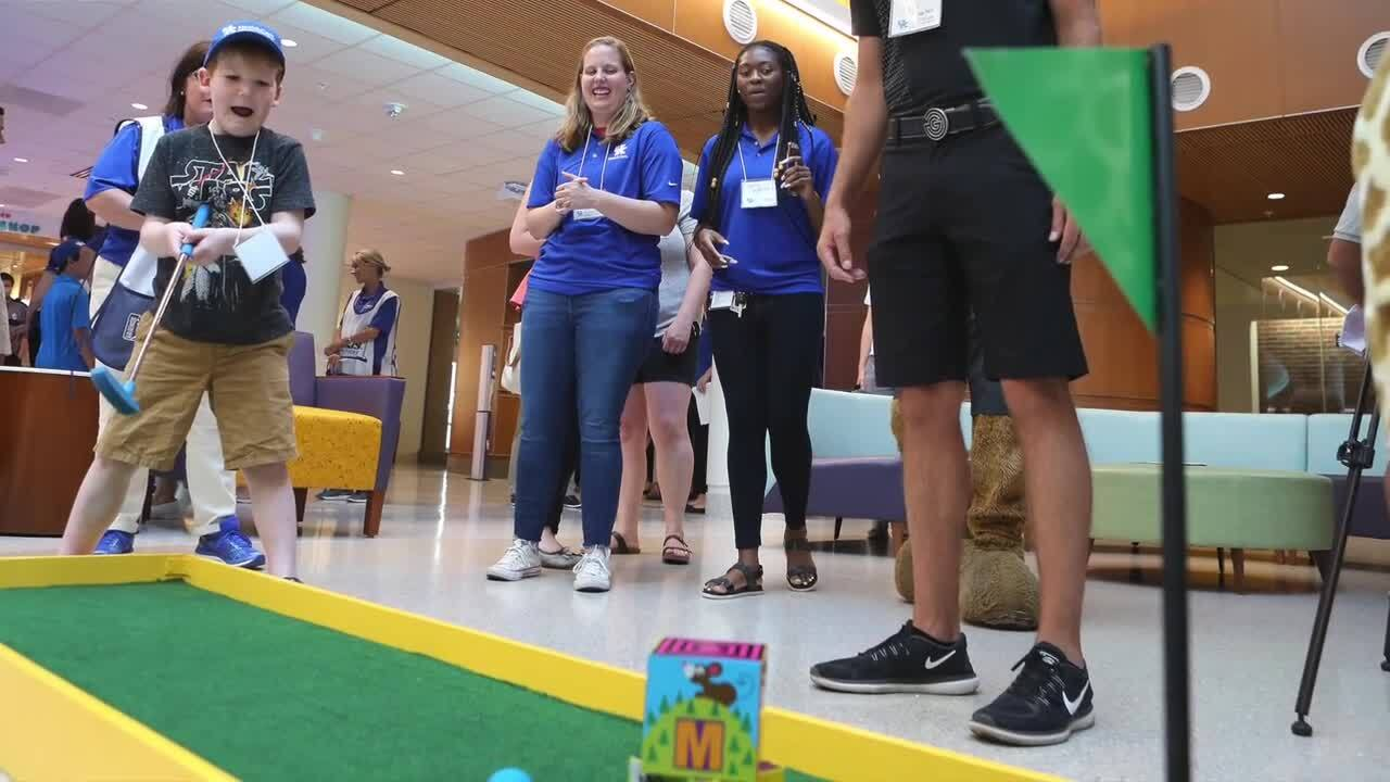 UK football team, PGA pros team up to brighten kids' spirits