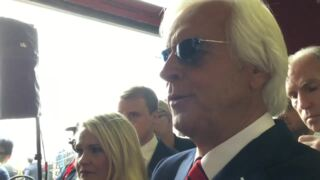Trainer Bob Baffert watches Justify hold on to win Preakness