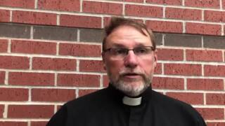 Father Daryl Befort speaks after St. Joseph Catholic Church fire