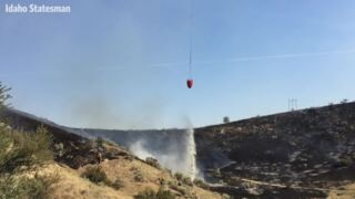 Boise Foothills fire: Helicopter drops water on blaze
