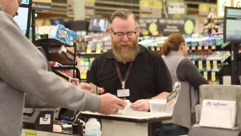 Half empty? Half full? How about just full? Albertsons cashier makes sure you 'choose joy'