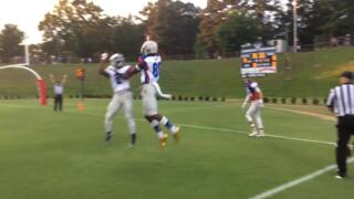 Southeast Raleigh's Justin Harrington hauls in 22-yard touchdown pass