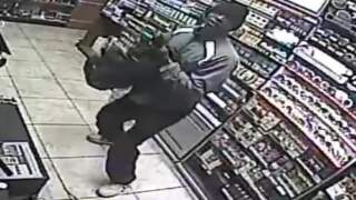 Watch burglars frantically steal beer and cigarettes