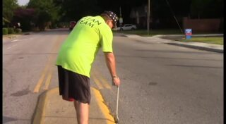 Clayton Woodward helps keep Rosewood neighborhood clean