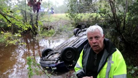 Driver 'narrowly escaped death' after car flips into water off I-10, Coast fire chief says