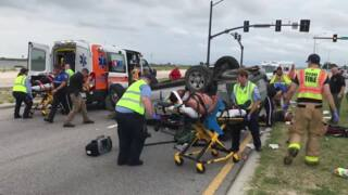 3 people injured after SUV flips in Biloxi
