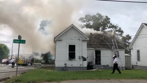 Macon-Bibb County firefighters pull man from burning house in Payne City neighborhood