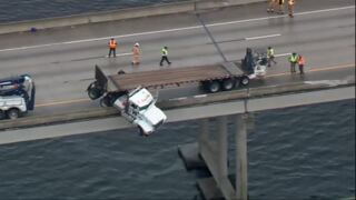 Cab of truck dangles from I-75 bridge in Florida