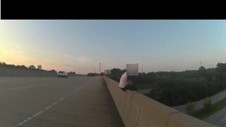 Bodaycam video shows deputy pulling suicidal man from overpass ledge