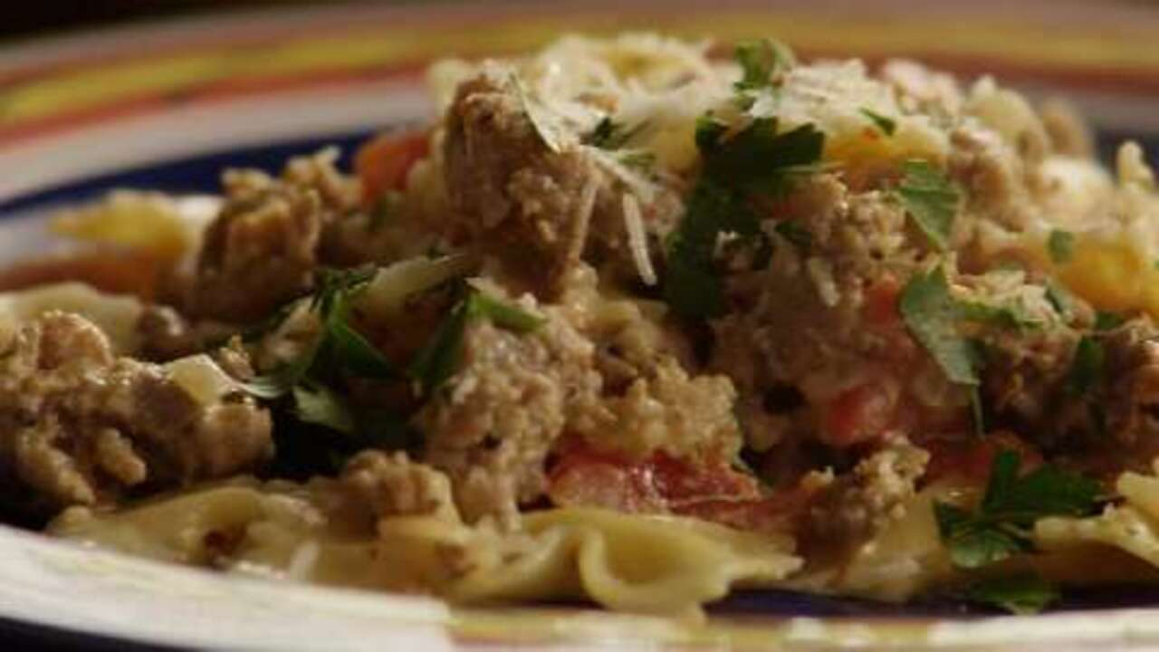 bow ties with sausage tomatoes and cream video
