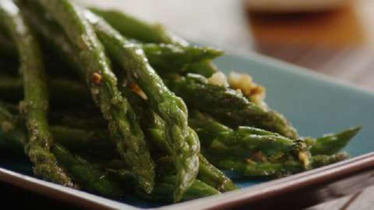 Saut 233 Ed Garlic Asparagus Video Allrecipes Com