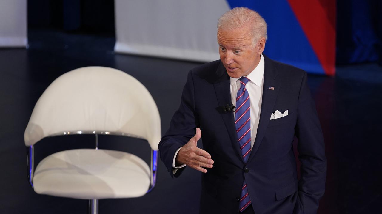 Biden uses town hall to name-check Manchin and Sinema on agenda hold-ups